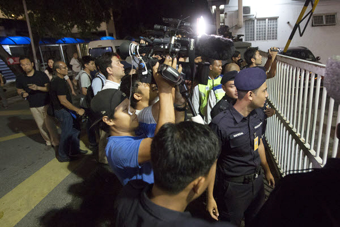 Day and night, reporters from all over the world camped outside HKL, where Kim's body is being kept.