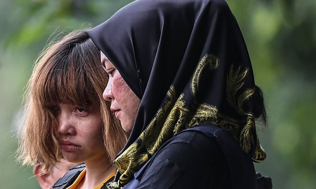 Doan Thi Huong (left) was seen escorted to the court in Sepang yesterday.