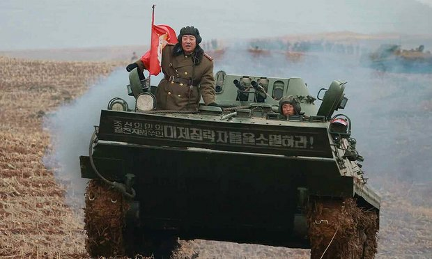 North Korean defence minister Hyon Yong-chol riding an armoured personnel carrier.