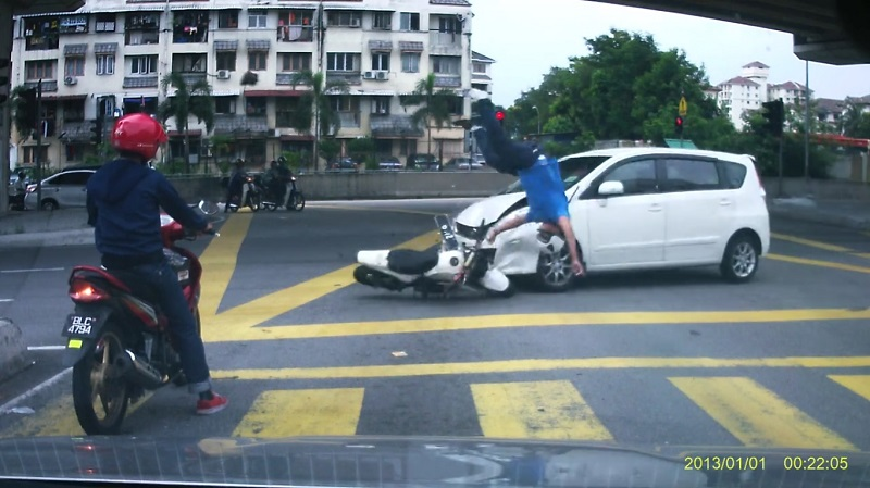 Viral Video Shows How An Accident In KL Sent A Motorcyclist Flying