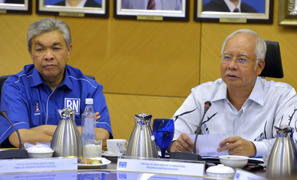 PM Najib Razak with DPM Zahid speaking to the reporters after chairing BN supreme council.