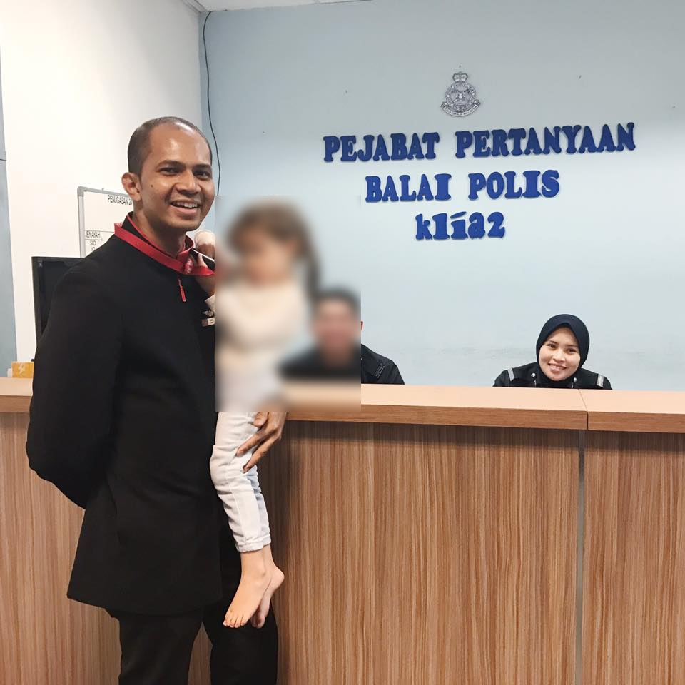 Heng's daughter Olivia with one of the crew member from AirAsia at the police station in KLIA2.