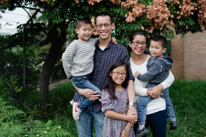 Eddie Woo with his wife, Michelle and three kids.
