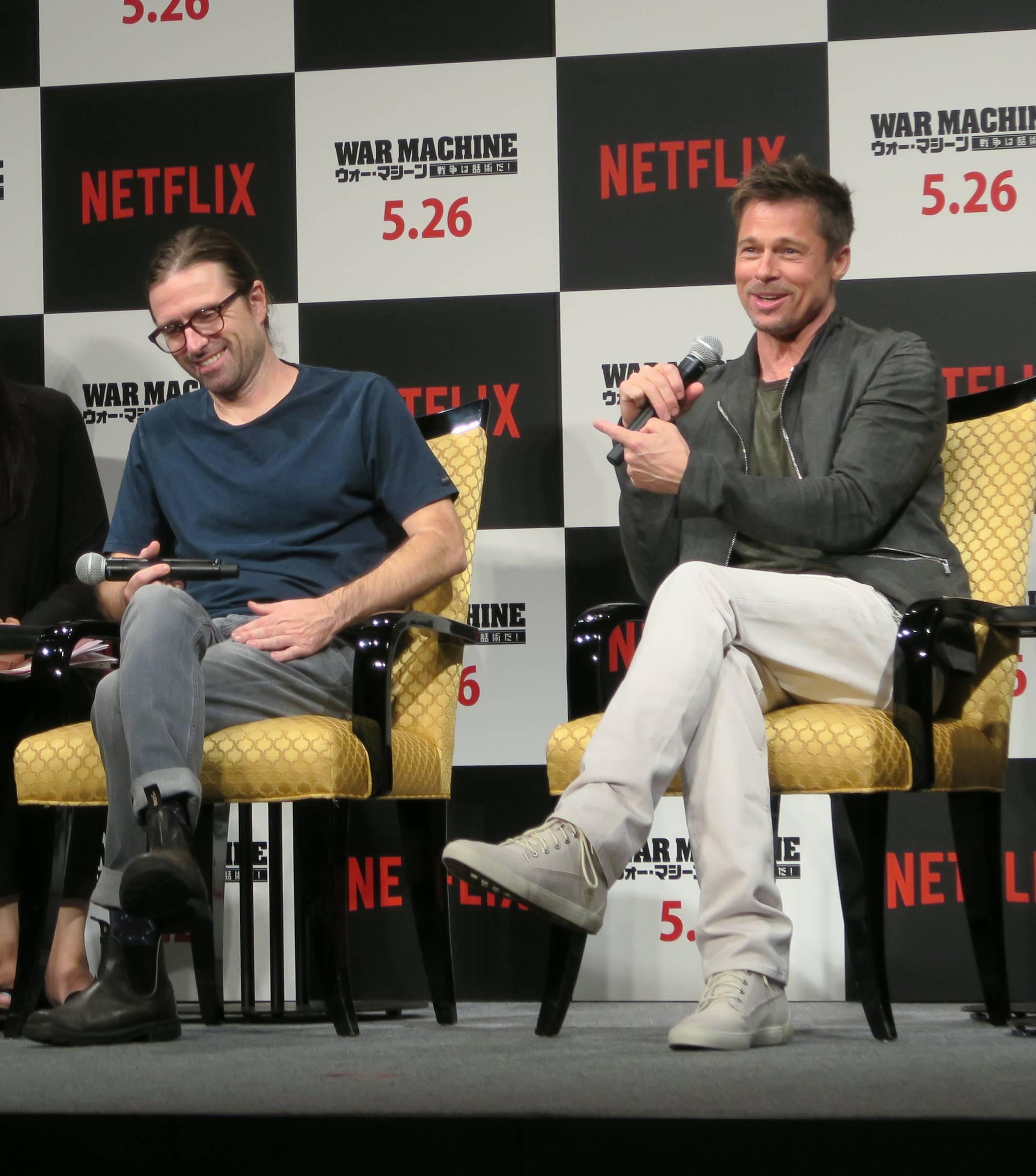 David Michôd (left) and Brad Pitt (right) shares a joke at the Japan press conference for the Netflix original film 'War Machine'.
