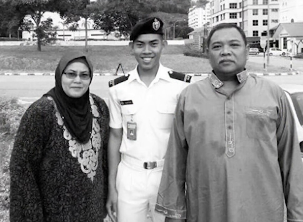 The late Navy cadet officer with his parents.
