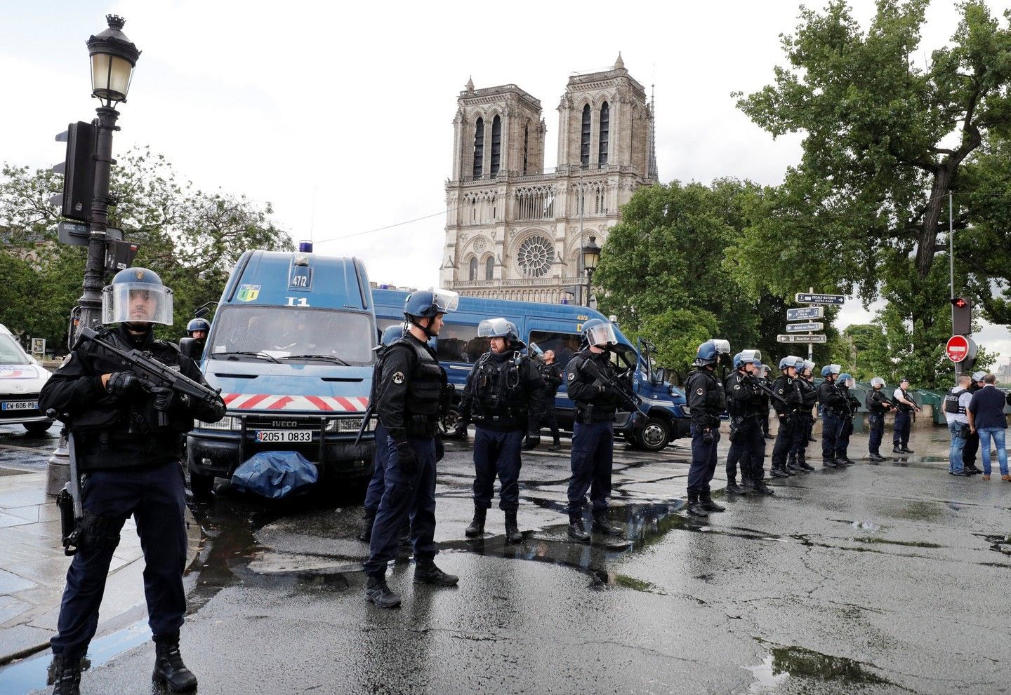 French police stand at the scene of the hammer-attack incident near the Notre Dame Cathedral.