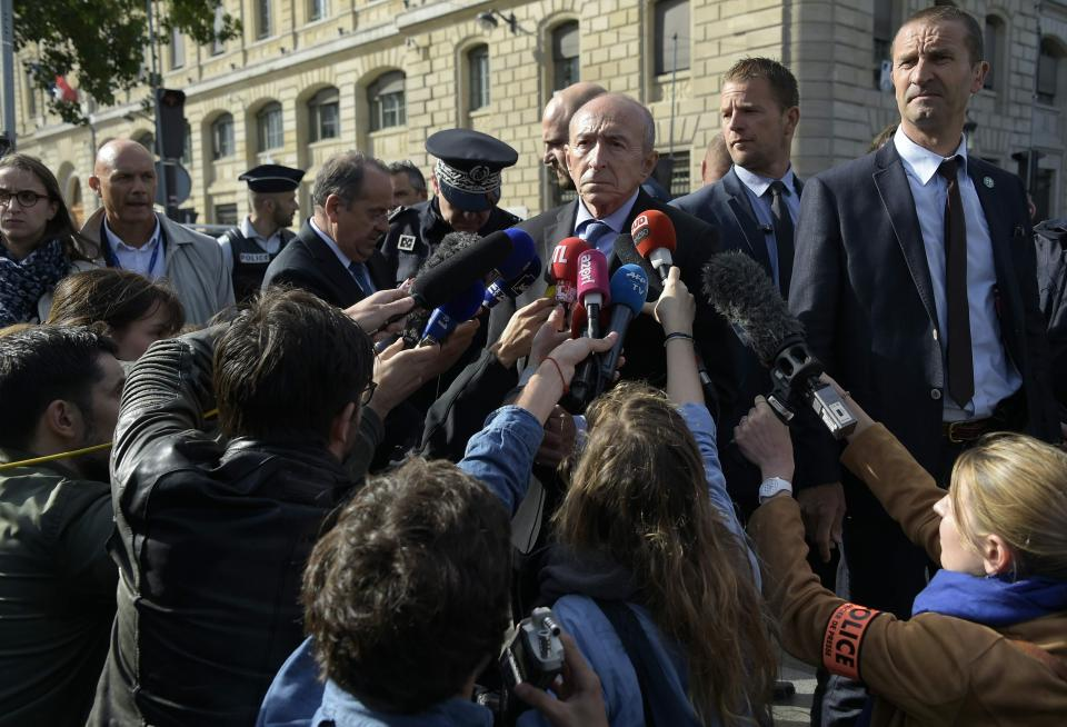 French Interior Minister Gérard Collomb speaks to reporters near Notre Dame.
