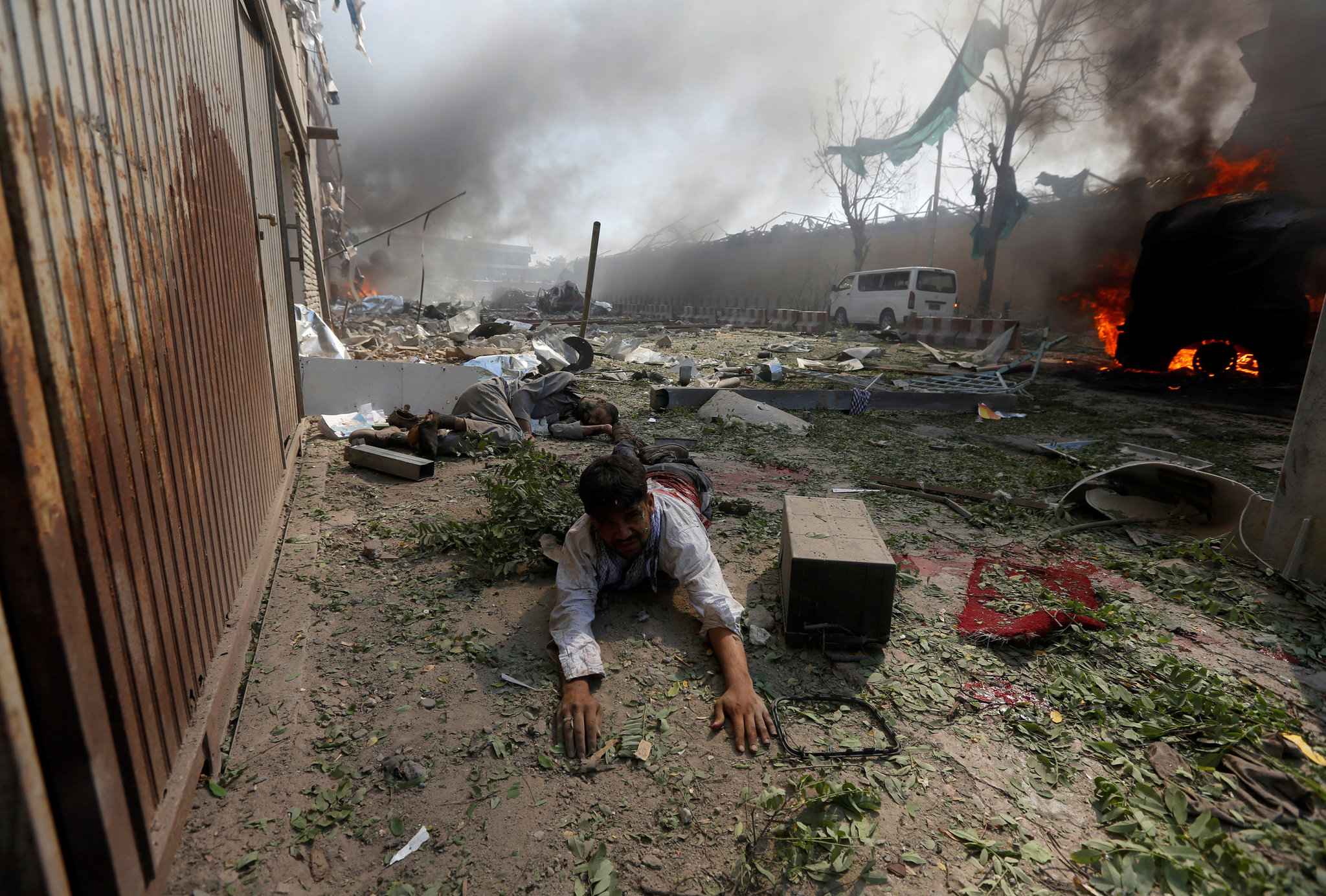 A wounded man at the site of a huge explosion in Kabul.