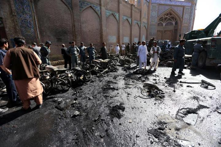 Afghan security officials inspect the scene of a bomb blast outside the Great Mosque in Herat.