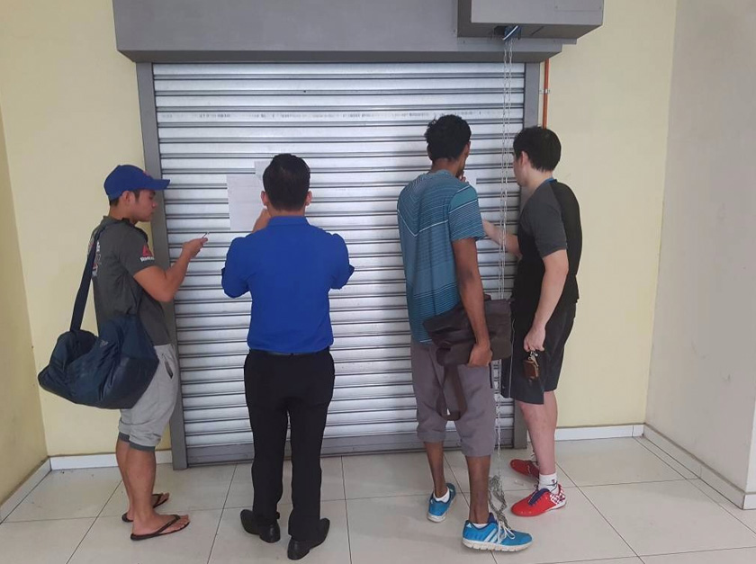 Some of the members who turned up at the branch gyms today only to find its shutters closed with a paper stuck onto it notifying them of the closure.