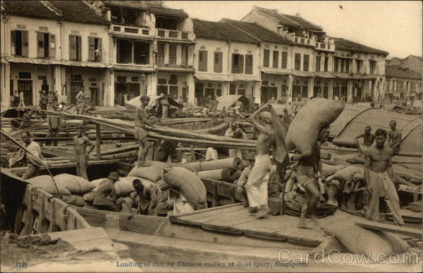 Chinese coolies hard at work at Boat Quay, Singapore in the 20th century.