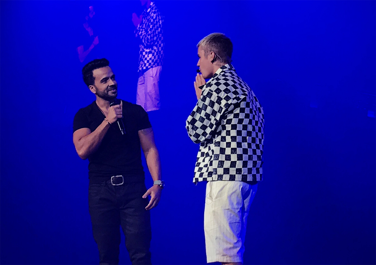 Luis Fonsi (left) made a surprise appearance during Justin Bieber's (right) Purpose Tour at the José Miguel Agrelot Coliseum in Puerto Rico on 18 April.