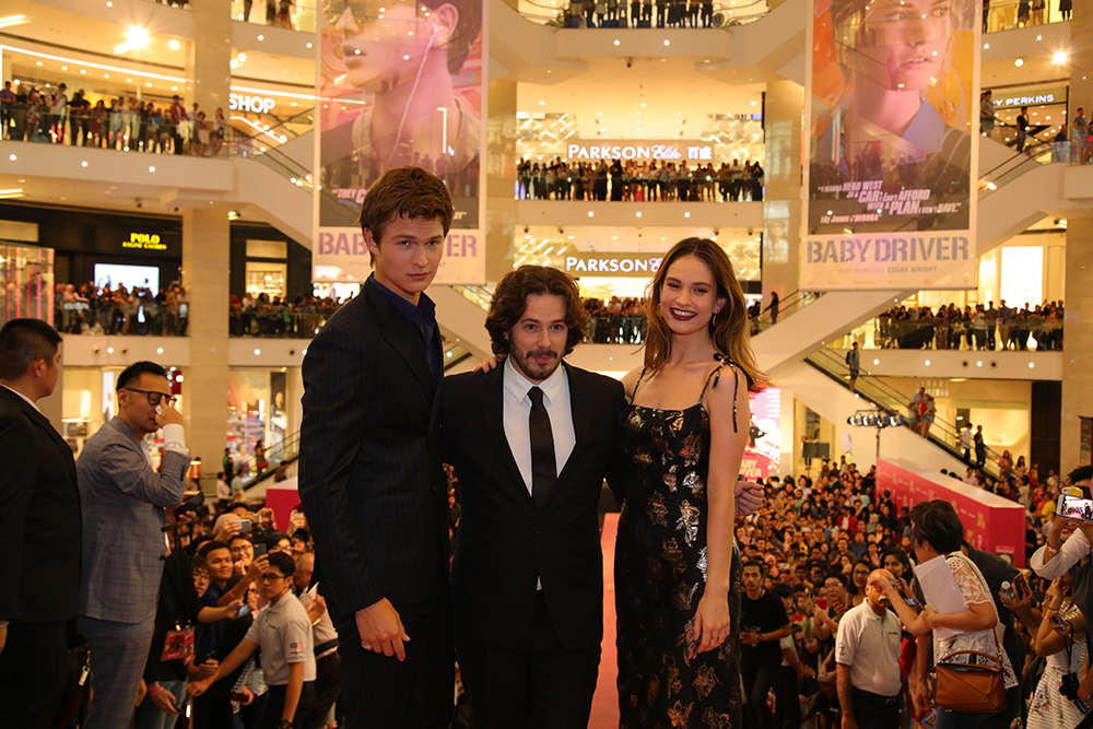 From left: Ansel Elgort, Edgar Wright, and Lily James at the red carpet premiere of 'Baby Driver' on 17 July.