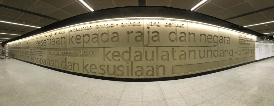 The Rukun Negara tenets engraved on the wall in the MRT Merdeka station.