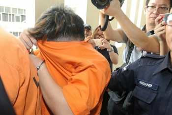 The suspect at the Petaling Jaya magistrate's court on 12 June.