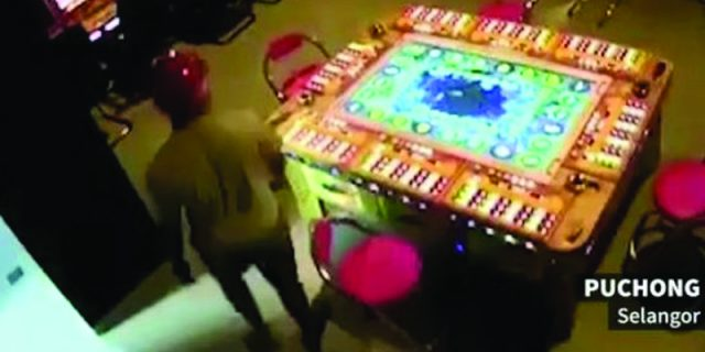A screenshot of the CCTV footage that shows one of the suspects entering the gambling den.