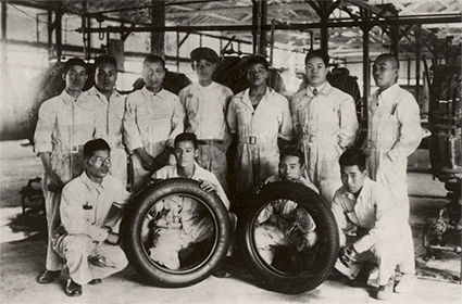 Tyre builders with the first Bridgestone tyres produced in 9 April 1930.