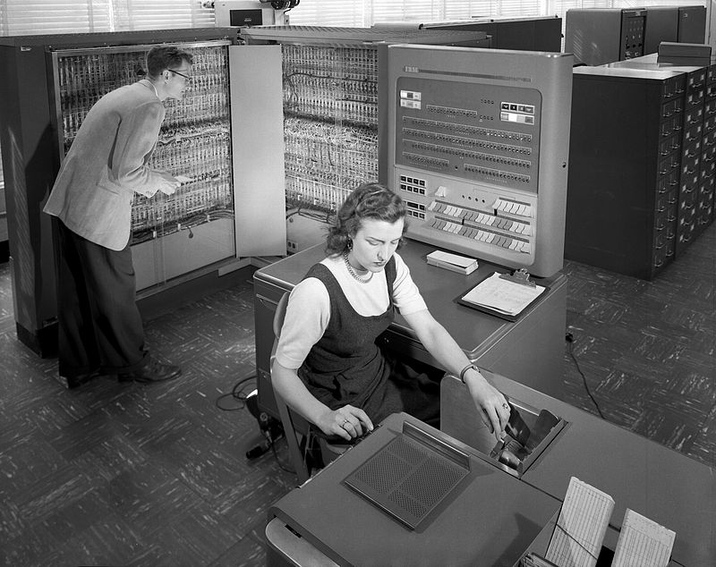 National Advisory Committee for Aeronautics (NACA) researchers using an IBM type 704 electronic data processing machine in 1957.
