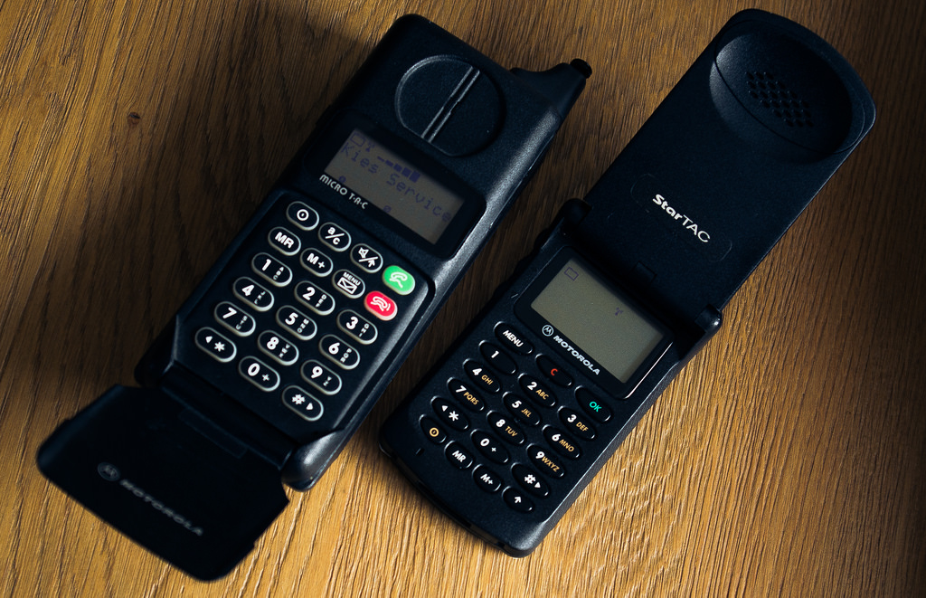 The Motorola MicroTAC (left) and StarTAC Wearable Phone (right).