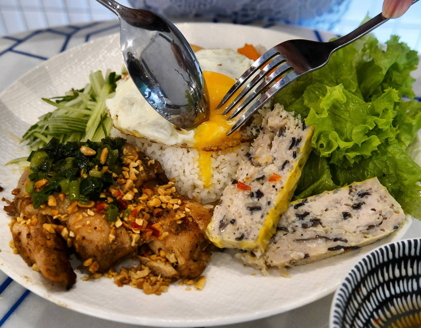 Com tam is available too! The Broken Rice dish is served with a choice of lemongrass chicken or grilled lamb.
