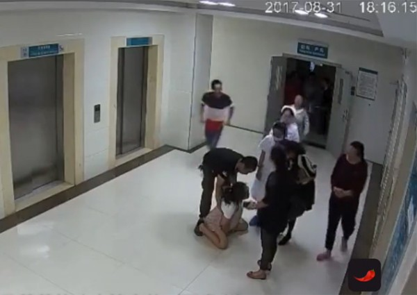 The pregnant woman seen pleading to her family.