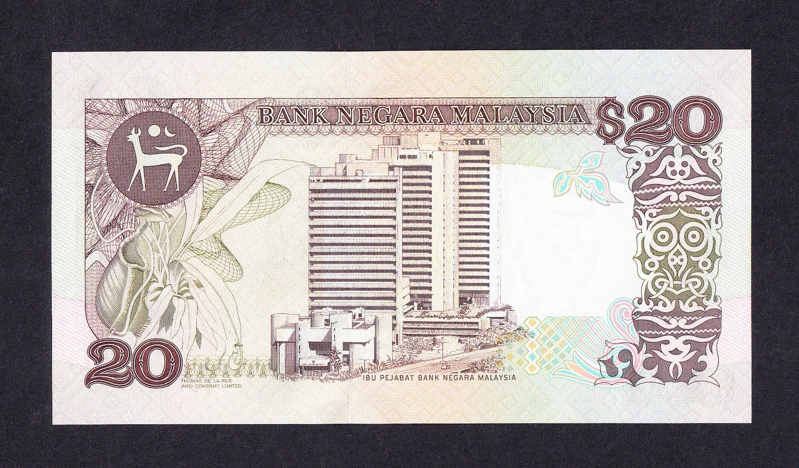 RM20 note with a right angle view of Bank Negara's headquarters