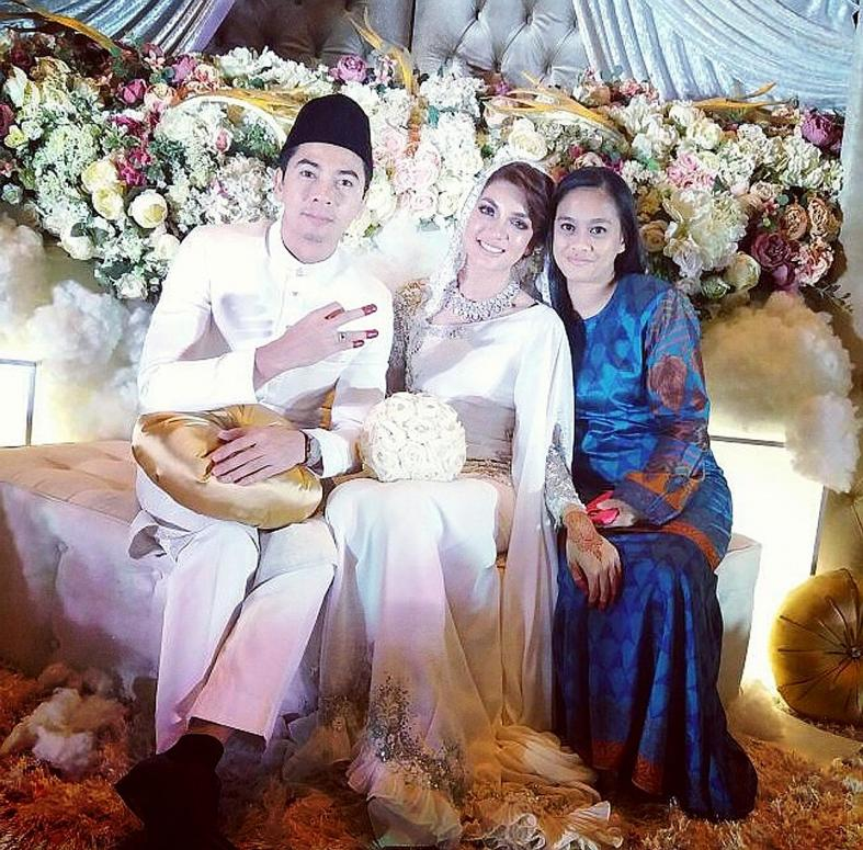 Amar Baharin and Amyra Rosli with Asliani Abdul Ghani (right) at one of the couple's wedding receptions in Kuala Lumpur.