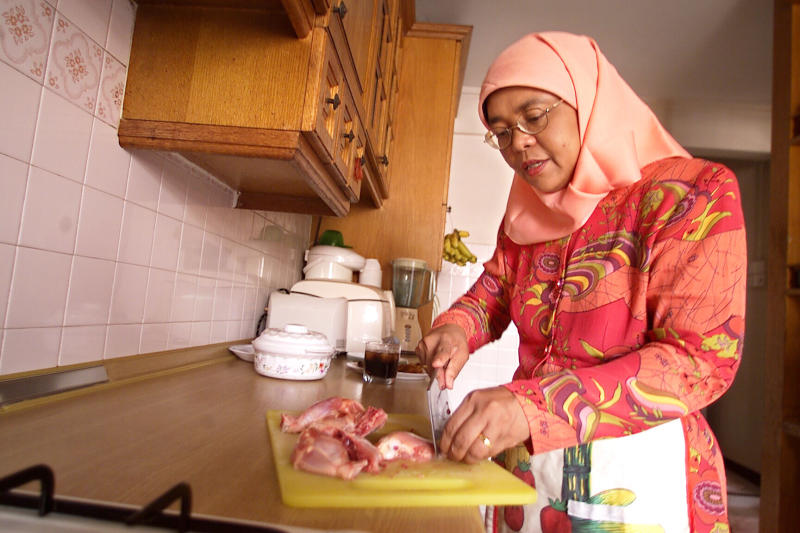 Halimah, photographed preparing her own food at home in 2004.