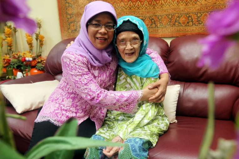 Halimah photographed with her mother who passed away on 11 September 2015.