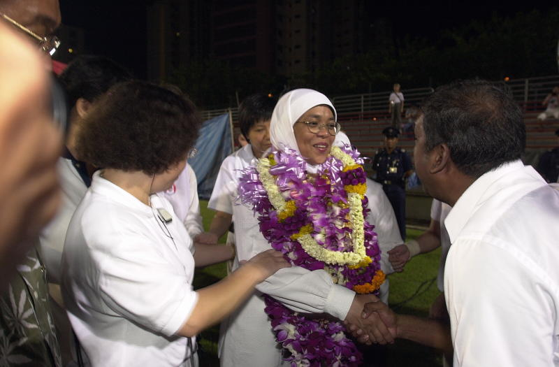 Halimah congratulated by supporters during Singapore's 2001 general election.