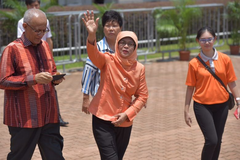 Halimah Yacob greeting supporters at People's Association (PA) today, 13 September.