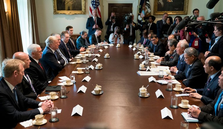 President Trump and other top American officials, left, met at the White House with Prime Minister Najib Razak of Malaysia and his delegation, right, on Tuesday.