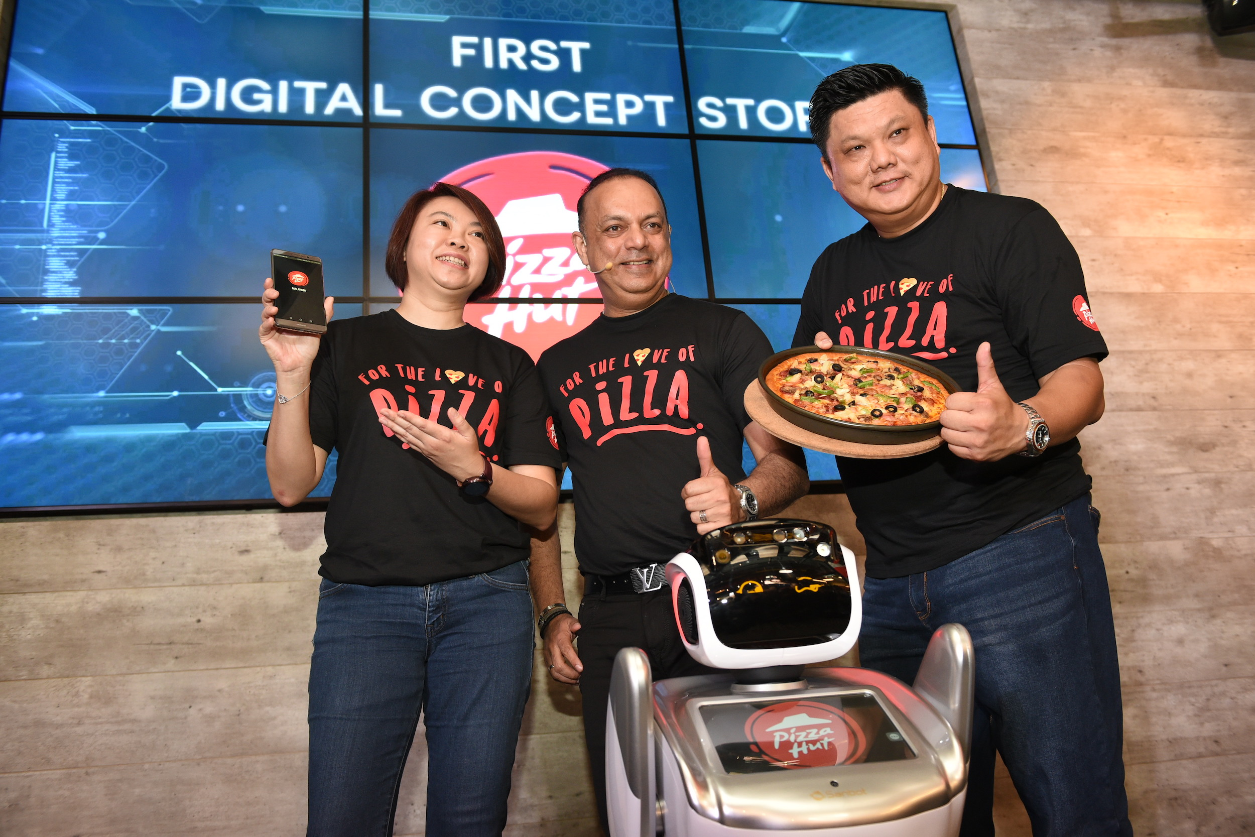 (L-R) Merrill Pereyra, CEO of QSR Brands (M) Holdings Bhd, Jean Ler, Chief Marketing Officer of Pizza Hut Malaysia and Eric Leong, Head of Pizza Hut Malaysia officiating the launch of Pizza Hut's first digital concept store and mobile app.