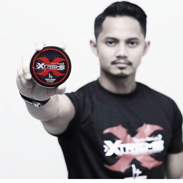Hairul Azreen posing with a tin of Hipster Pomade Extreme.