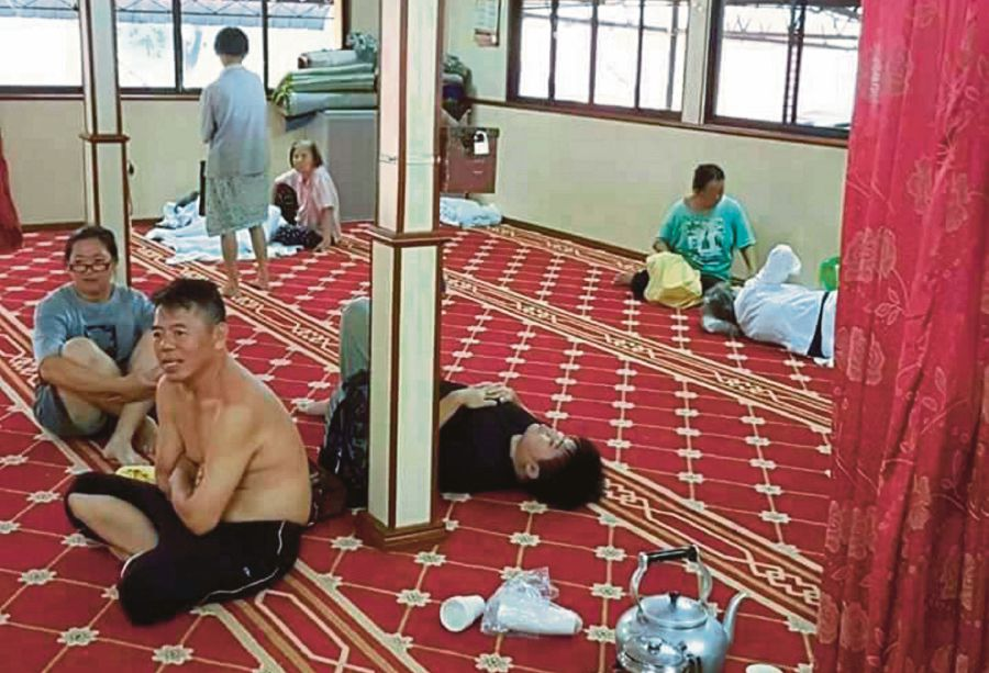 Some of the flood victims at the Taman Free School surau on Sunday, 5 November.