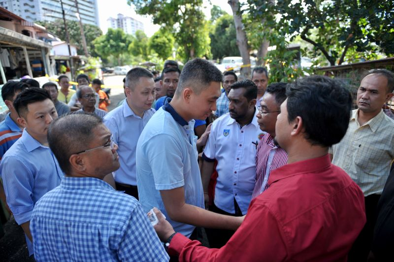 Friends encircle Swee Bok who lost his entire family in the space of a week.