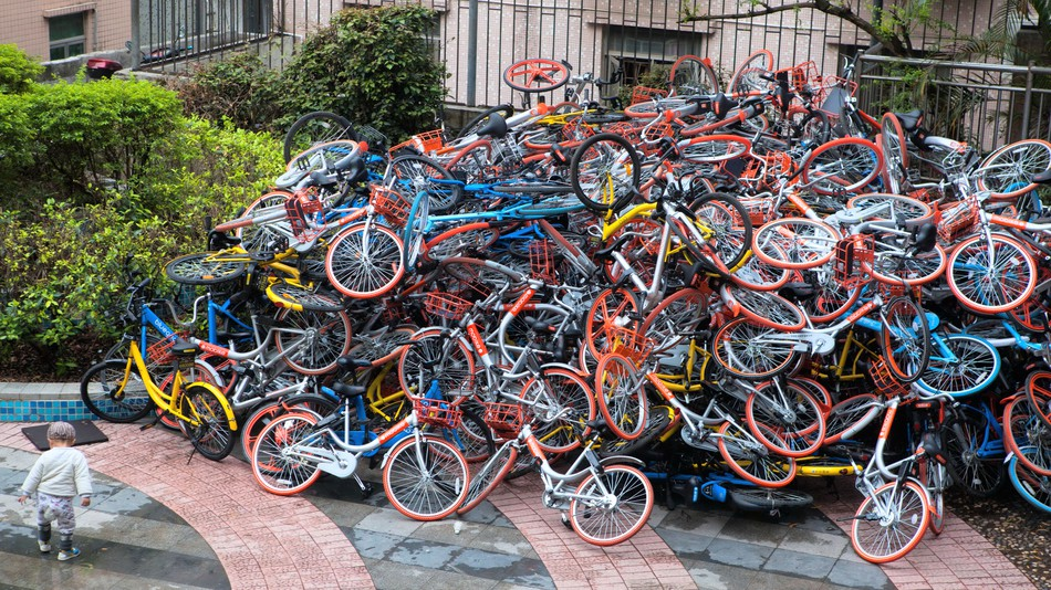 People in China are reportedly destroying bikes after use. Broken bicycles are then dumped in a pile.