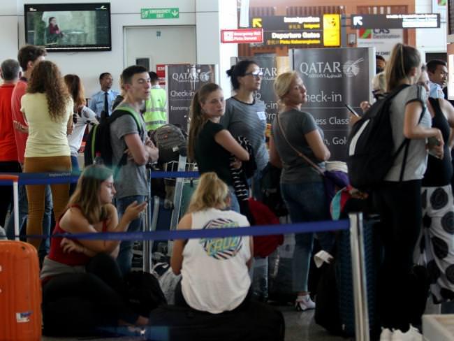 Stranded travellers at the Ngurah Rai International Airport in Bali