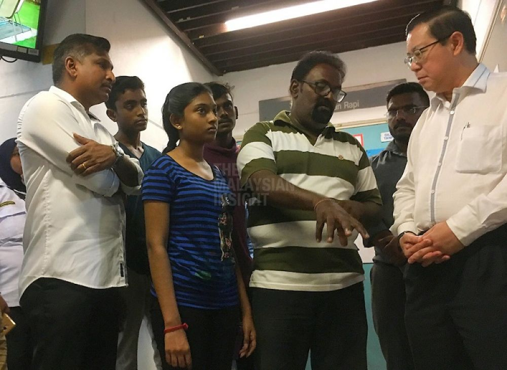 The girl's father telling Penang Chief Minister Lim Guan Eng on Monday what happened to his daughter Vasanthapiriya.