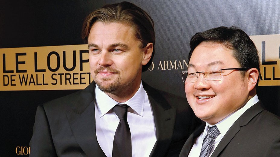 Jho Low (right) and Leonardo DiCaprio at the premiere of The Wolf of Wall Street in Paris in December 2013.