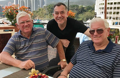 Anthony Wong with John and David Perry.