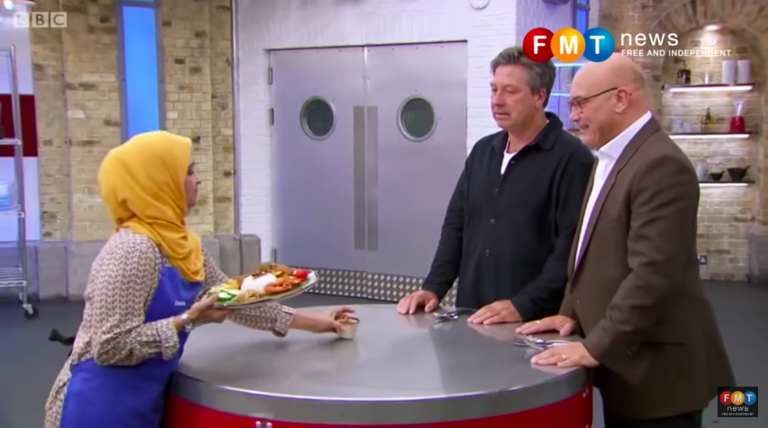 Zaleha (left) presenting her nasi lemak dish to judges John Torode (middle) and Gregg Wallace (right). The original video has since been deleted from the official MasterChef account, though it has been reuploaded by Free Malaysia Today.