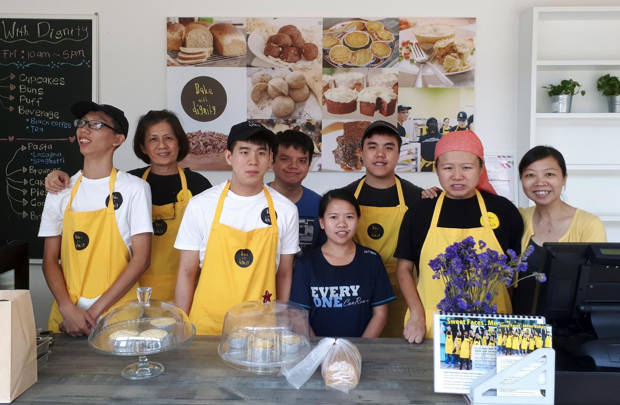 Dignity and Services executive director Helen Teh (most right) and coach Marina Lim (second from left) with the special bakers and staff at Bake With Dignity.