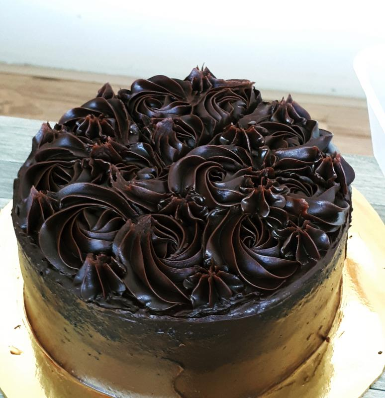 Make sure you try Bake With Dignity's chocolate moist with Belgian chocolate topping cake.