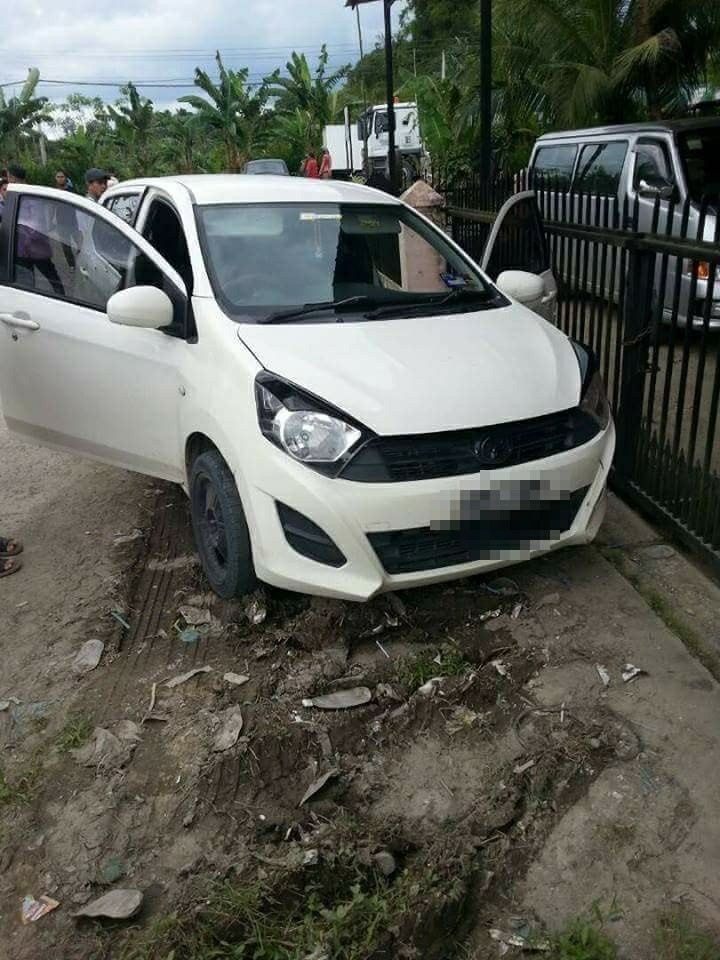The victim's Perodua Axia after he lost control of it and crashed into the gate of a housing area.