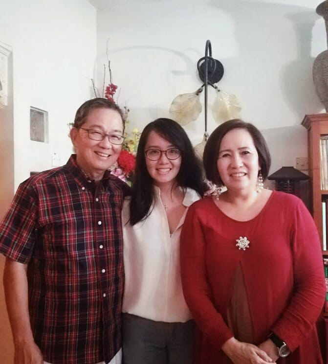 Michelle with her parents.