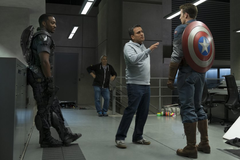 Joe Russo (middle) directing Anthony Mackie (left) and Chris Evans (right) in Captain America: Winter Soldier.