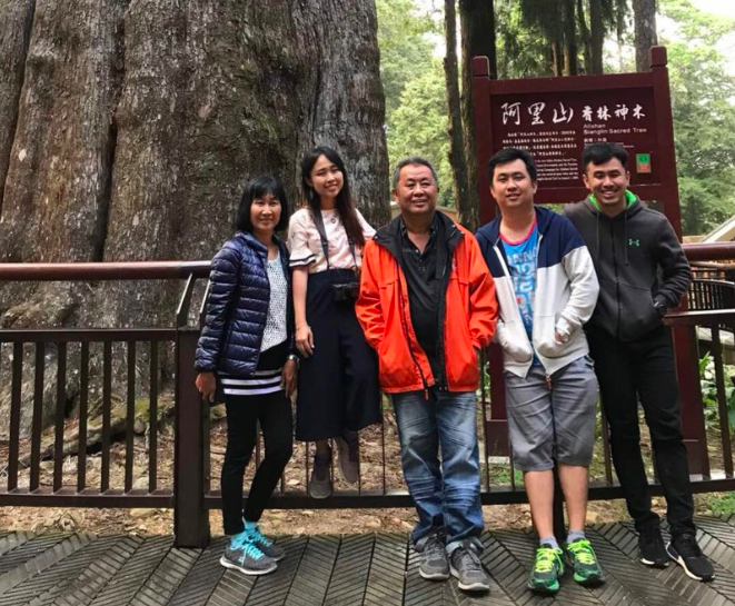 Hou (middle in orange jacket) with his family in Taiwan.