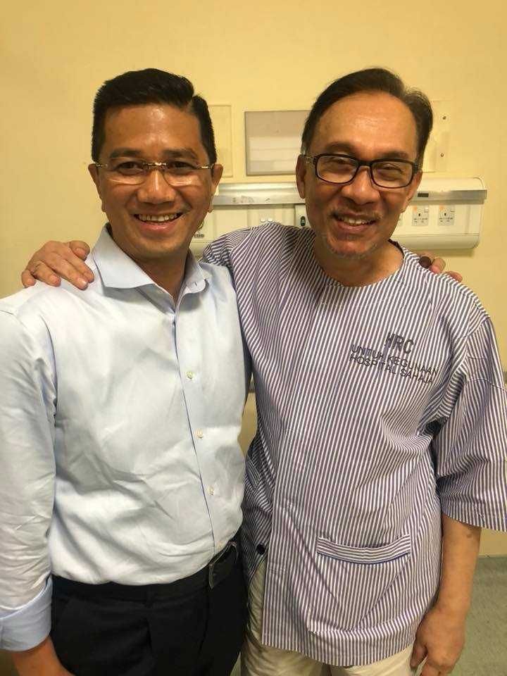 Anwar with Azmin in hospital last night, from where he was watching Dr M's swearing-in ceremony.