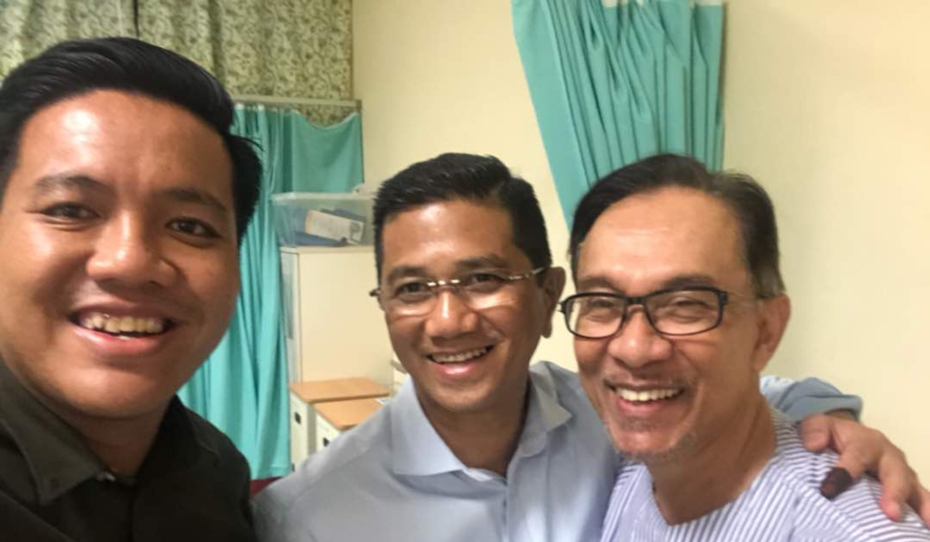 Anwar watched Mahathir's swearing-in ceremony with two long time loyalists Azmin Ali and Afif Bahardin while recuperating at the Cheras Hospital.